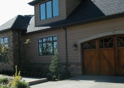 The exterior boasts wood windows, heavy cedar skirl siding, slate patio with water feature, clear cedar fencing, trellises, gates and custom clear cedar garage doors.